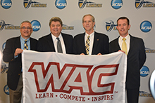 (From left) Kent Dacus, Dr. Ronald L. Ellis, Jeff Hurd (commissioner of Western Athletic Conference) and Dr. Micah Parker display the WAC conference banner at a press conference announcing California Baptist University's transition into a NCAA Division I conference on Jan. 13.