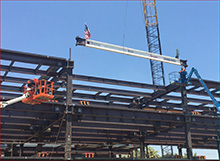 Final steel beam hoisted into place at the new Gordon and Jill Bourns College of Engineering