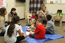 Graduate students from California Baptist University and a group of children gathered around a makeshift campfire to chat about tasty treats.