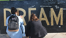 "With Martin Luther King Jr.'s historic ""I Have a Dream"" speech booming in the background, California Baptist University students lined up to write down their dreams on a large display in honor of the late minister and civil rights activist."
