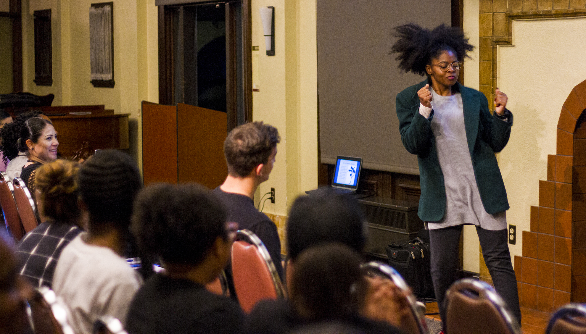 Margaret Jones, a psychology major at California Baptist University, demonstrates moves associated with hip-hop beats at a Slam Poetry Club event on Oct. 12.