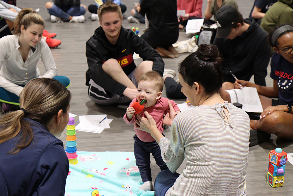 As babies kicked their legs, grabbed toys and sat up, students from California Baptist University observed the infantile, yet appropriate, movement.