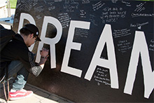 """California Baptist University students write down their own dreams or reflect on the Martin Luther King Jr. """"I Have a Dream"""" speech."""