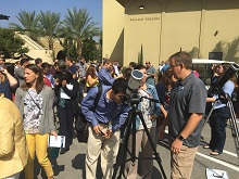 California Baptist University faculty and staff members use special eyeglasses and telescopes equipped with protective filters to view a solar eclipse described as the most observed in history.