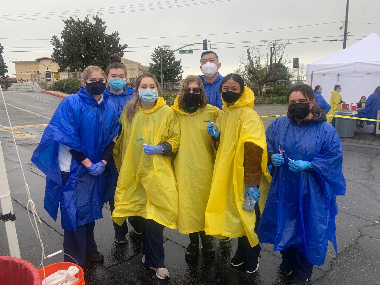 Nursing students from California Baptist University are assisting at COVID-19 vaccination clinics, helping to administer the injections.