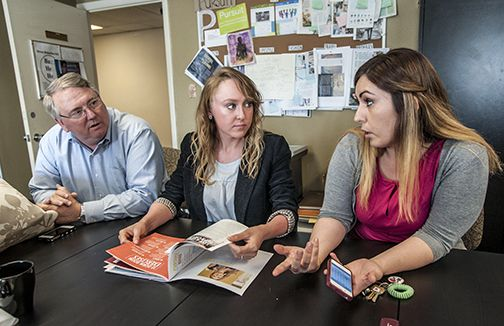 From left: Dr. Michael Chute, professor of journalism and director of the Journalism & New Media and Public Relations program; Grace Ferrell Belton, graduate assistant; and Pursuit advisor Sandra Romo work with students to produce the magazine.