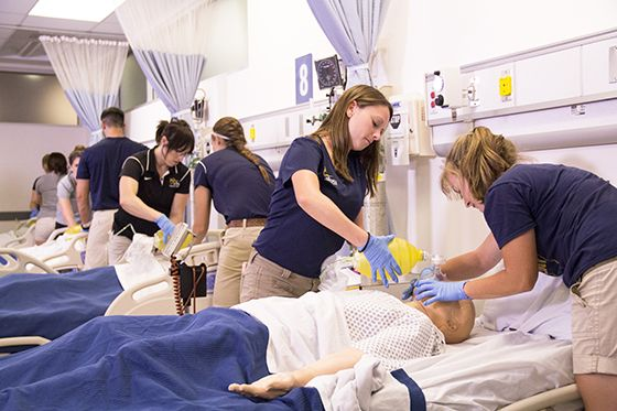 Students work on simulators during an athletic training lab.