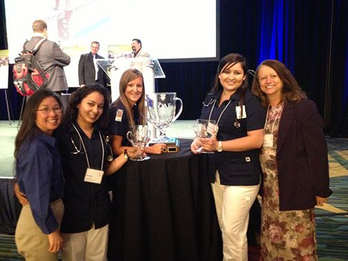 Left to right: Victoria Randazzo, CBU lecturer; students Brenda Ruiz, Rebecca Weldon and Genevieve Monge; and Susan Nelson, assistant professor of nursing, with the CAE Cup.