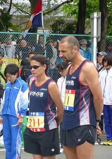 The runners observed a moment of silence before the race to remember the victims of the tsunami that hit Sendai two years ago. From left: Mizuki Noguchi, Japan's gold medalist in the marathon at the 2004 Olympic Games; Theresa Hoag, who represented Riverside in the women's race; and Dr. Jeff Cate. Noguchi won the Sendai Half Marathon for the women in 1:10.
