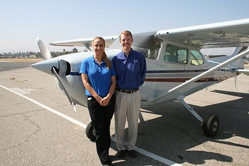 Maria LeBlanc, CBU's chief flight instructor, and Daniel Prather, chair of the department of aviation science, show off one of the three Cessna 172 single engine planes in the university's current fleet.